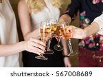 hands holding the glasses of... | Shutterstock . vector #567008689
