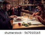 dinner for couple in restaurant ... | Shutterstock . vector #567010165