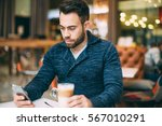young man sitting at cafe and... | Shutterstock . vector #567010291