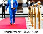 groom in bright blue suit walks ... | Shutterstock . vector #567014005
