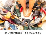 bare feet in the midst of many... | Shutterstock . vector #567017569