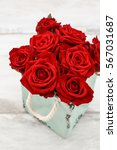 Stock photo red roses inside the ceramic box romantic floral arrangement for valentines day 567031687