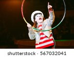 funny clown performs at the... | Shutterstock . vector #567032041
