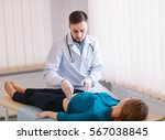 the doctor examines the patient. | Shutterstock . vector #567038845