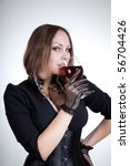 beautiful woman drinking red... | Shutterstock . vector #56704426