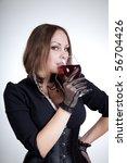 beautiful woman drinking red... | Shutterstock . vector #56704426