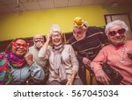 group of seniors taking selfie... | Shutterstock . vector #567045034