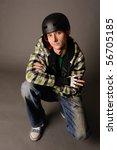 Young male teen in helmet, studio shot. - stock photo