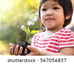 asian kid hand holding young... | Shutterstock . vector #567056857