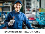 auto mechanic smiling in his... | Shutterstock . vector #567077257