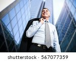 Confident Businessman Holding...