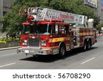 TORONTO-JULY 6: Fire-truck from Toronto Fire Department is taking part in 136th annual Shriners Parade down University Ave  on July 06, 2010 in Toronto - stock photo