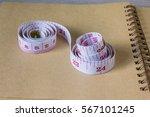 tape measure on blank note... | Shutterstock . vector #567101245