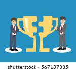 businessman giving trophy to... | Shutterstock .eps vector #567137335