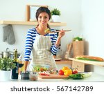 young woman eating fresh salad... | Shutterstock . vector #567142789