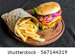 burger and french fries on a... | Shutterstock . vector #567144319