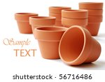 Little clay flower pots on white background with copy space.  Macro with shallow dof. - stock photo
