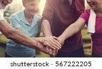 senior adult teamwork hands... | Shutterstock . vector #567222205