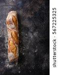 fresh baguette bread on dark... | Shutterstock . vector #567225325