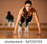 beautiful fit woman works out...   Shutterstock . vector #567253705