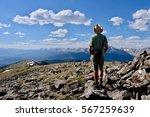 man hiking in colorado... | Shutterstock . vector #567259639