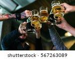 hands hold beverage beers... | Shutterstock . vector #567263089