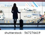 young woman in the airport ... | Shutterstock . vector #567276619