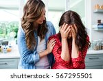 woman comforting worried friend ... | Shutterstock . vector #567295501