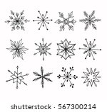 Hand-drawn doodle snowflakes set.