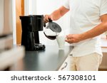 man in the kitchen pouring a... | Shutterstock . vector #567308101