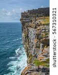 Small photo of Tourists on Dun Aengus cliffs, Inishmore, Ireland, August-11-2014