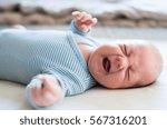 cute newborn baby boy lying on... | Shutterstock . vector #567316201