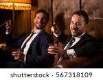 rich businessmen resting and... | Shutterstock . vector #567318109