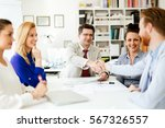 businesspeople shaking hands in ... | Shutterstock . vector #567326557