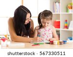 mother playing with her little... | Shutterstock . vector #567330511
