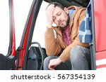 driver in cabin of big modern... | Shutterstock . vector #567354139