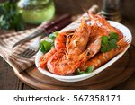 grilled king prawns or shrimps... | Shutterstock . vector #567358171