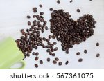 real fried coffee beans spilled ... | Shutterstock . vector #567361075