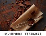cocoa powder on parchment | Shutterstock . vector #567383695
