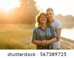 smiling mature woman being... | Shutterstock . vector #567389725