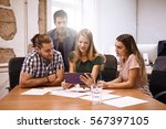 team of professionals around a... | Shutterstock . vector #567397105
