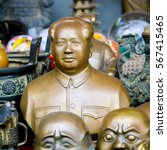Small photo of BEIJING, CHINA - SEPTEMBER 17, 2007: Bust of Chairman Mao and other memorabilia on an antique market in Beijing, China