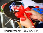 a girl is making flower ribbon... | Shutterstock . vector #567422344