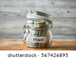 dollar bills in glass jar... | Shutterstock . vector #567426895
