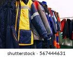 work clothes on hangers  closeup | Shutterstock . vector #567444631