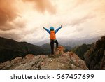 successful woman hiker open... | Shutterstock . vector #567457699