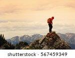 successful woman backpacker... | Shutterstock . vector #567459349