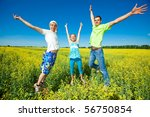 happy people is jumping in field | Shutterstock . vector #56750854