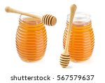 honey in glass jar isolated on... | Shutterstock . vector #567579637