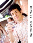 guy at a cafee having a drink... | Shutterstock . vector #5675938